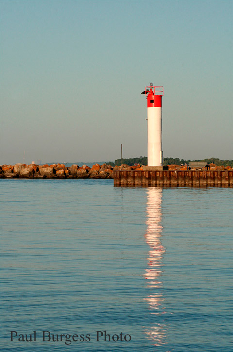 Whitby's harbour light, early on a still morning.